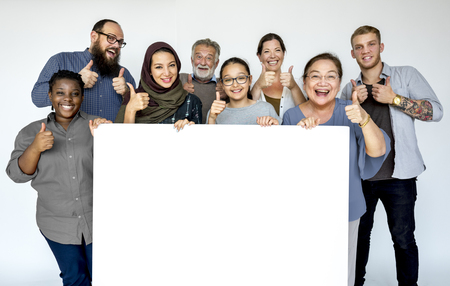 Group of diversity people with copyspace board advertising and thump up Banco de Imagens - 83008556