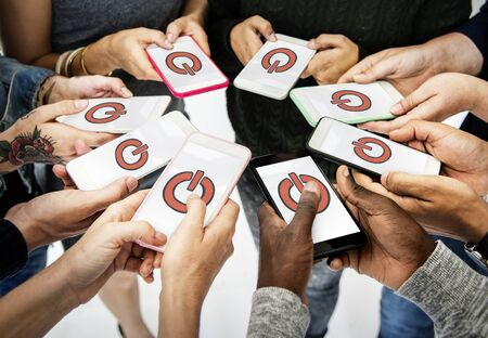 techie: Hands holding digital device network graphic overlay Stock Photo
