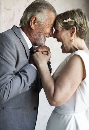 Senior Couple Holding Hands Together Cheerful Stock Photo