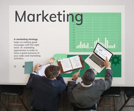 Workers working on network graphic overlay billboard on table 版權商用圖片