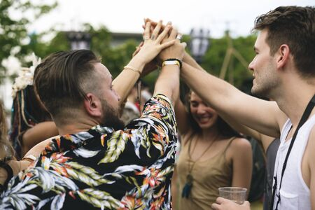 Friends Hands Together Unity at Festival Event
