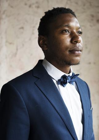 African Descent Groom in Navy Blue Tuxedo Wedding Marriage Ceremony