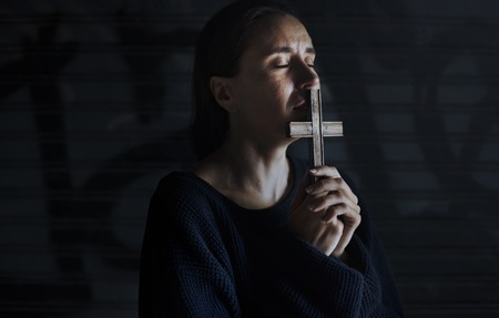 Adult Woman Hands Holding Cross Praying for God Religion 版權商用圖片