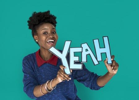Smiling African Woman Holding Yeah Word Stok Fotoğraf - 82955855
