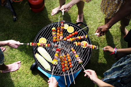Aerial view of diverse friends grilling barbecue outdoors Zdjęcie Seryjne