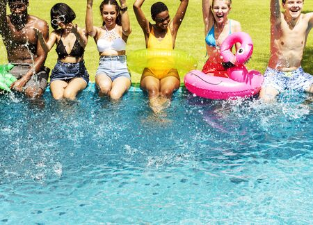 Group of diverse friends enjoying summer time by the pool