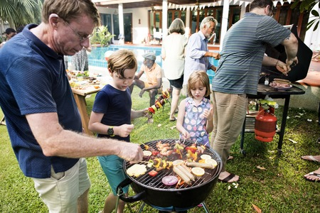 Diverse people enjoying barbecue party together