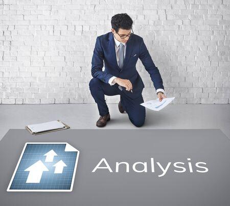 Businessman plan and analysis market growth Stock Photo
