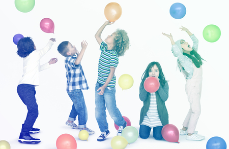 Young children playing with balloons Stock Photo