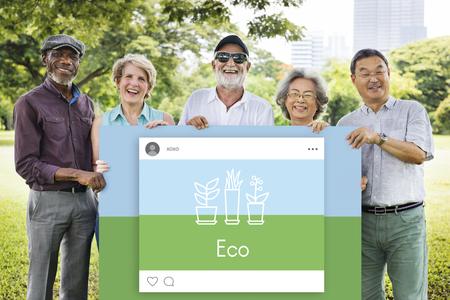 Senior people holding network graphic overlay billboard Stock Photo