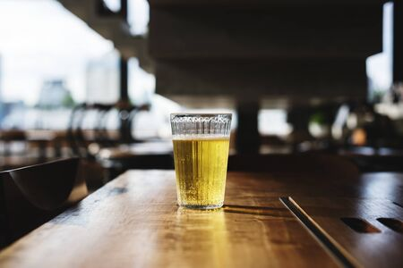 Beer glass on wooden bar