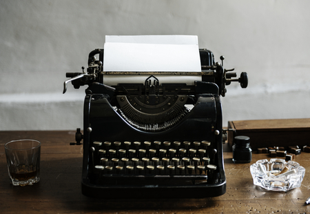 Closeup of retro vintage typewriter on wooden table Stock Photo