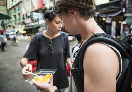 Tourist trying mango with sticky rice Thai dessert