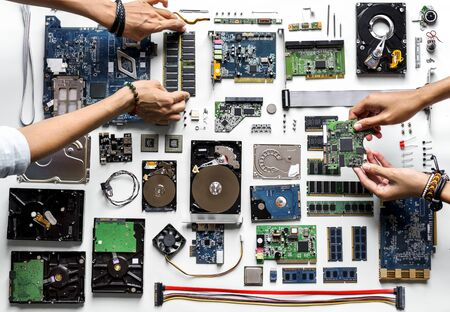 Aerial view of hands with computer electronics parts on white background Фото со стока - 85344556