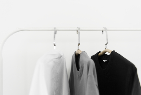 Clothes hanging on white background