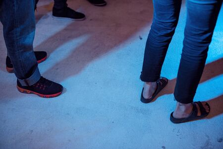 People legs with jeans standing