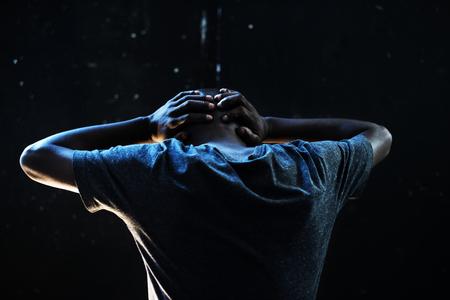 Depress adult man in the dark Standard-Bild