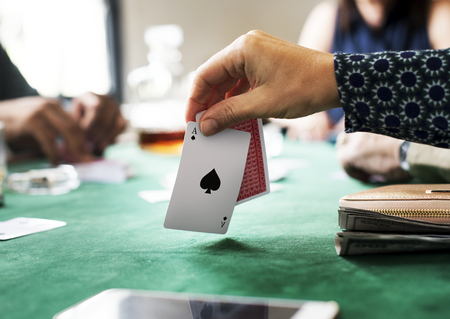 Hand holing card in a gambling game Stock Photo