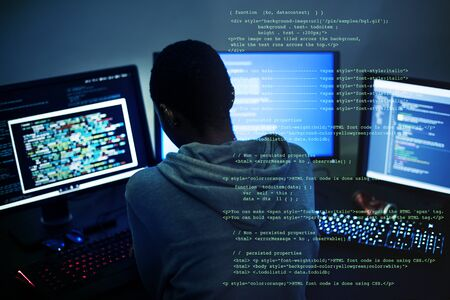 Hacker man working on computer