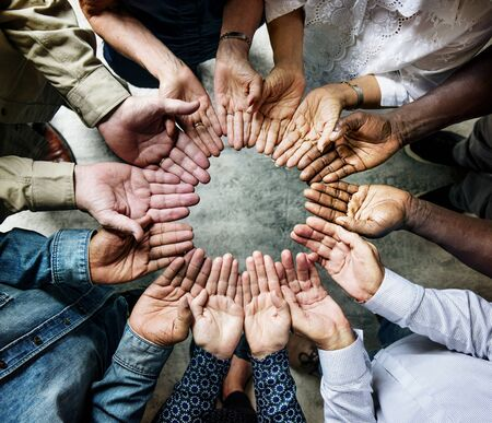 Group of diverse hands palms circle support together teamwork aerial view