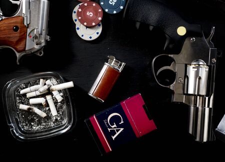 Gun chips cigarette lighter addicted