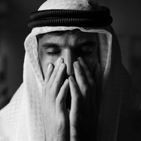 A thoughtful arab man grayscale