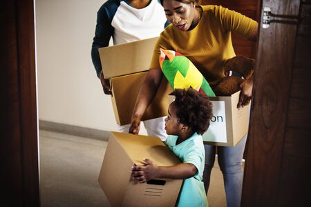 moving box: Black family moving in to their new house