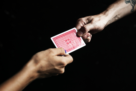 Hand to hand passing a card