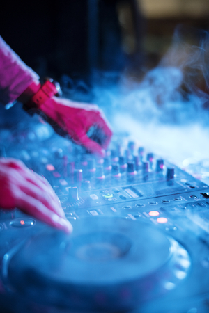 Hand on a sound mixer station Stock Photo