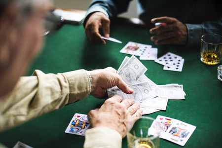 Group of people playing cards gambling Stok Fotoğraf
