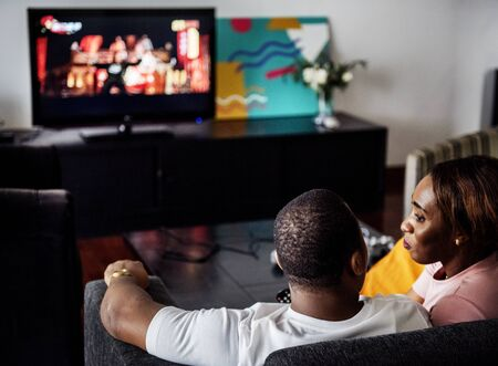 Black spouse watching movie enjoy precious time together