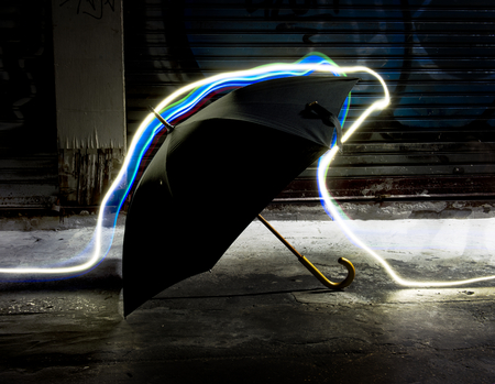 Long exposure light lines movement over umbrella
