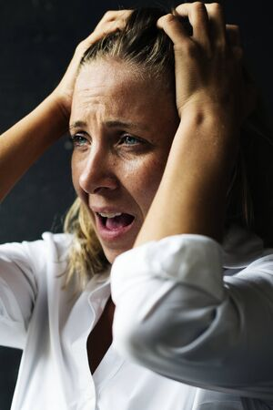 Woman stressing face expression