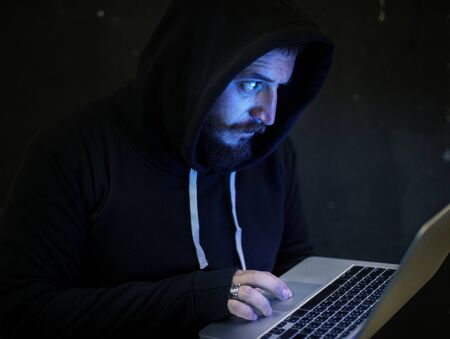 Hacker working on computer cyber crime 版權商用圖片