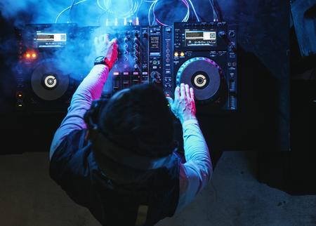 DJ is on a mixer station Standard-Bild