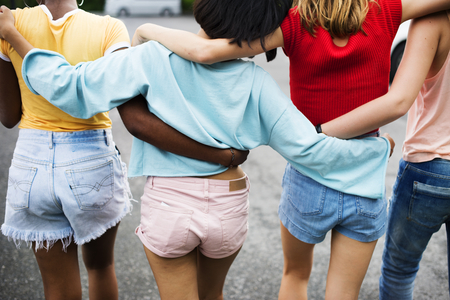 Rear view of diverse women walking together Stock Photo