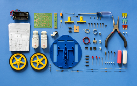 Aerial view of electronics tools equipments on blue background Banco de Imagens