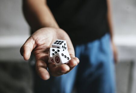 Hands holding dices