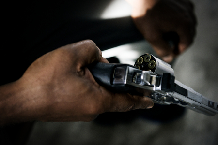 Hands holding the gun