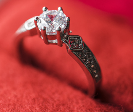 Closeup of diamond ring in red velvet box macro Stock Photo