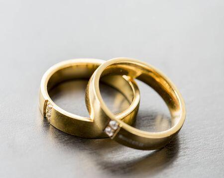 Closeup of couple golden rings macro Stock Photo