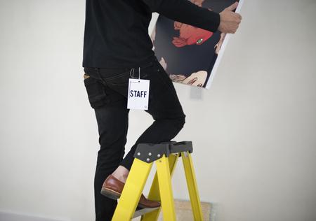 Man taking care of frames in an exhibition Reklamní fotografie