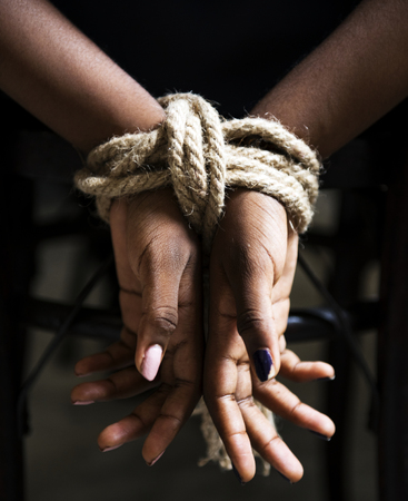 Hands tied with ropes