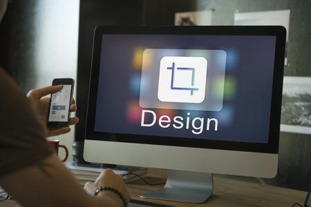 Man editing photos on a computer Stock Photo
