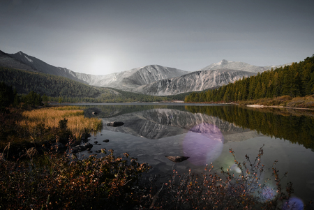 Mountains reflected in a lake, Mongolia Stock Photo