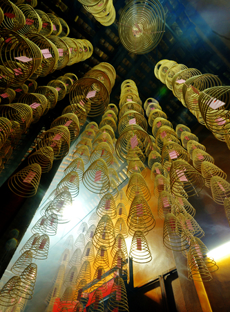 Incense coils burning in a Chinese temple. Imagens