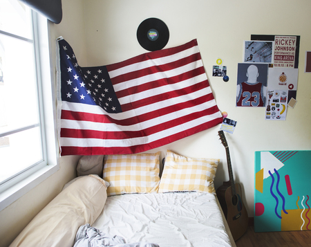 Bedroom with american flag hanging on the wall
