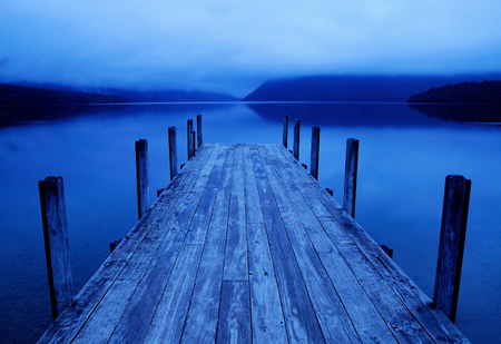 Tranquil peaceful lake with jetty.