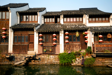 Traditional Chinese houses lining a canal in Suzhou, China.