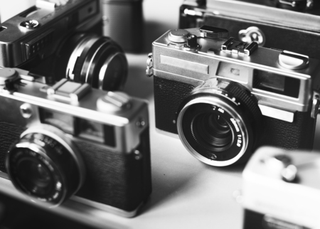 Group of vintage film cameras grayscale